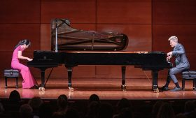 Piano duo performing on stage