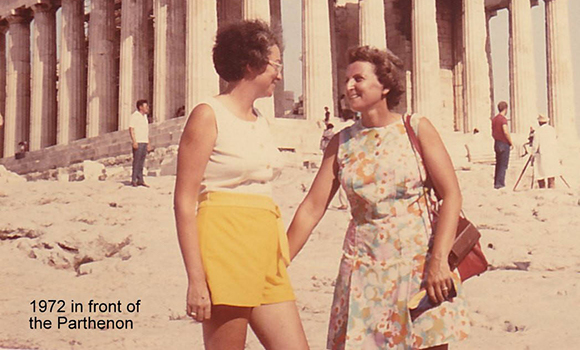 Lennie Gerber and Pearl Berlin hold hands and smile in front of Parthenon in Greece