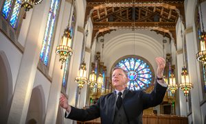 Photo of choral director in church sanctuary