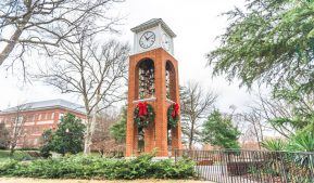 Photo of the Vacc Bell Tower with a wreath