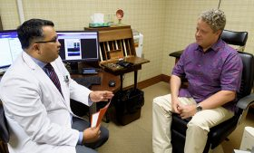 Doctor and patient sitting and discussing