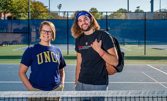 Photo of Lindsey Oakes and Brandon Baldwin on tennis courts