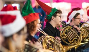 Horn players in holiday hats