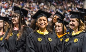Photo of smiling graduates at December commencement