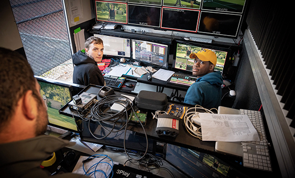 Photo of students working on broadcasts inside truck