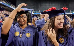 UNCG graduates turn their tassels at graduation.