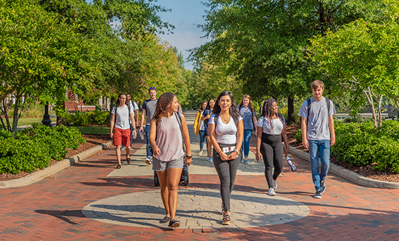 Photo of students walking on College Avenue on campus