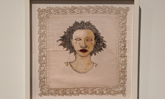 drawing of face on handkerchief