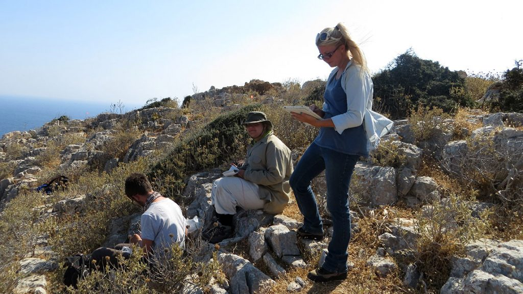 Photo of group of students conducting research on island
