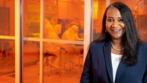 Portrait of Sherine Obare with lab space in the background