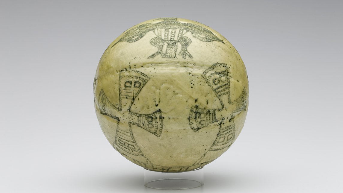 Photo of artwork that consists of a basketball that has been painted with different designs