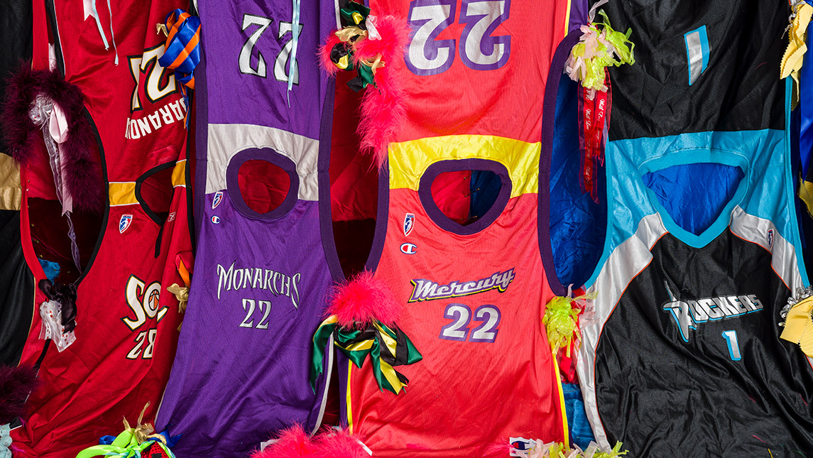Detail photo of art installation of WNBA jerseys