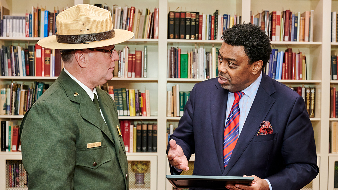 Superintendent of Guilford Courthouse National Memorial Park with the National Park Service speaking with Chancellor Gilliam