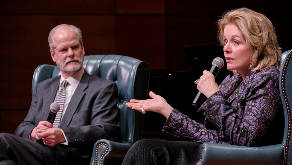Renee Fleming speaks into microphone as moderator listens.