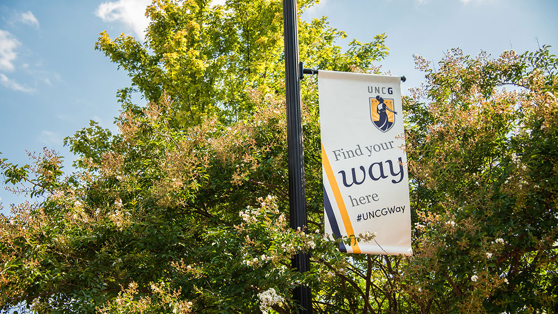 """Banner that says """"Find your way here"""" on campus"""