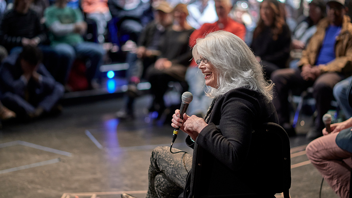 Emmylou Harris talking to room of people
