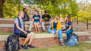 students sitting and talking on campus