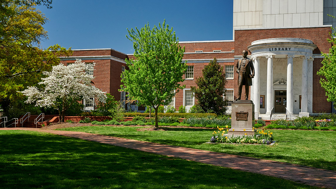 Photo of campus library and flowers