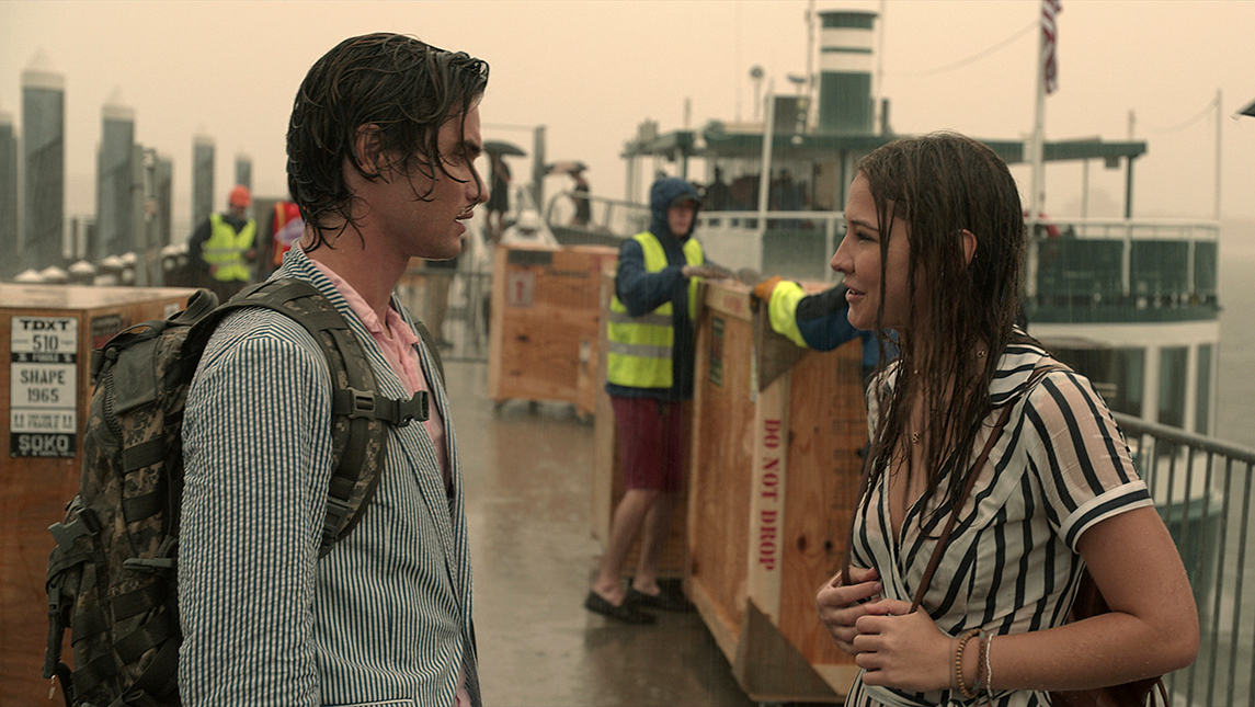 Production still from scene of John B. and Sarah in the rain