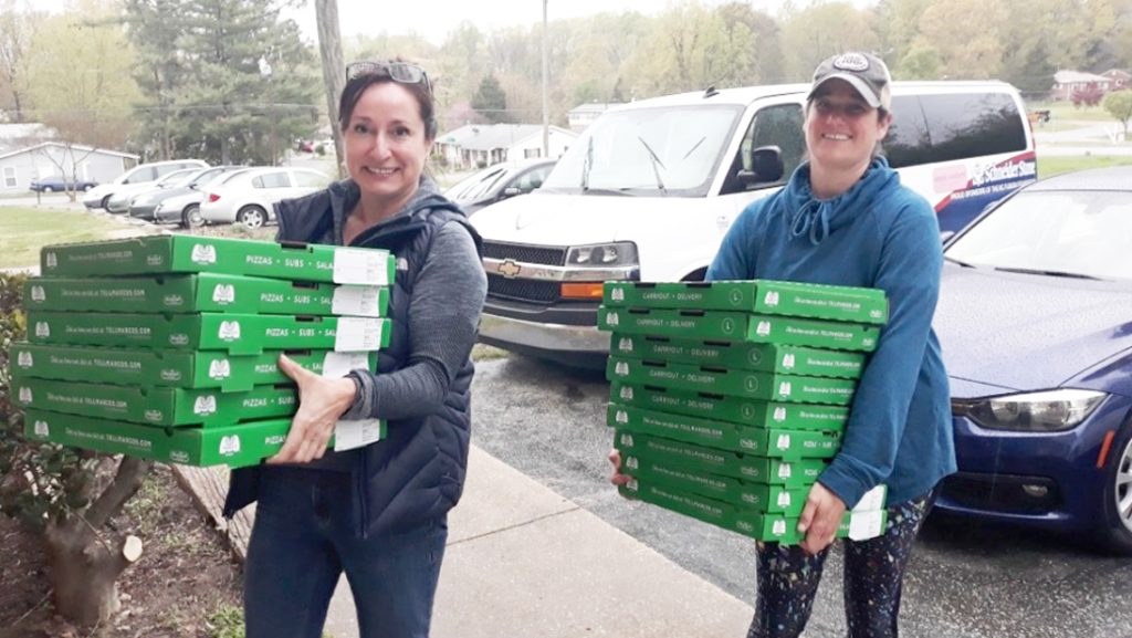 Sari Rose helps deliver pizzas to immigrant families