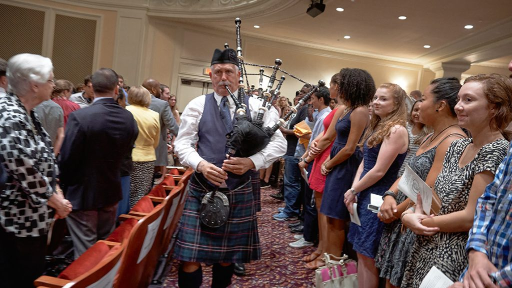 Man playing bagpipes at campus event