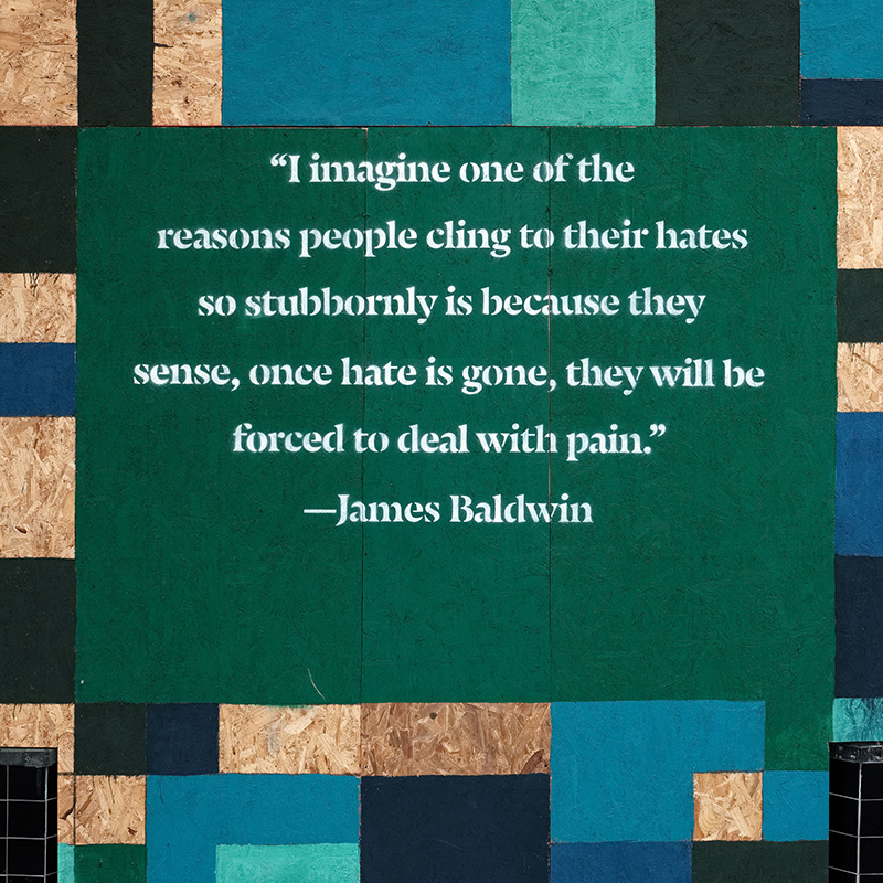 Photo of James Baldwin quote painted on plywood