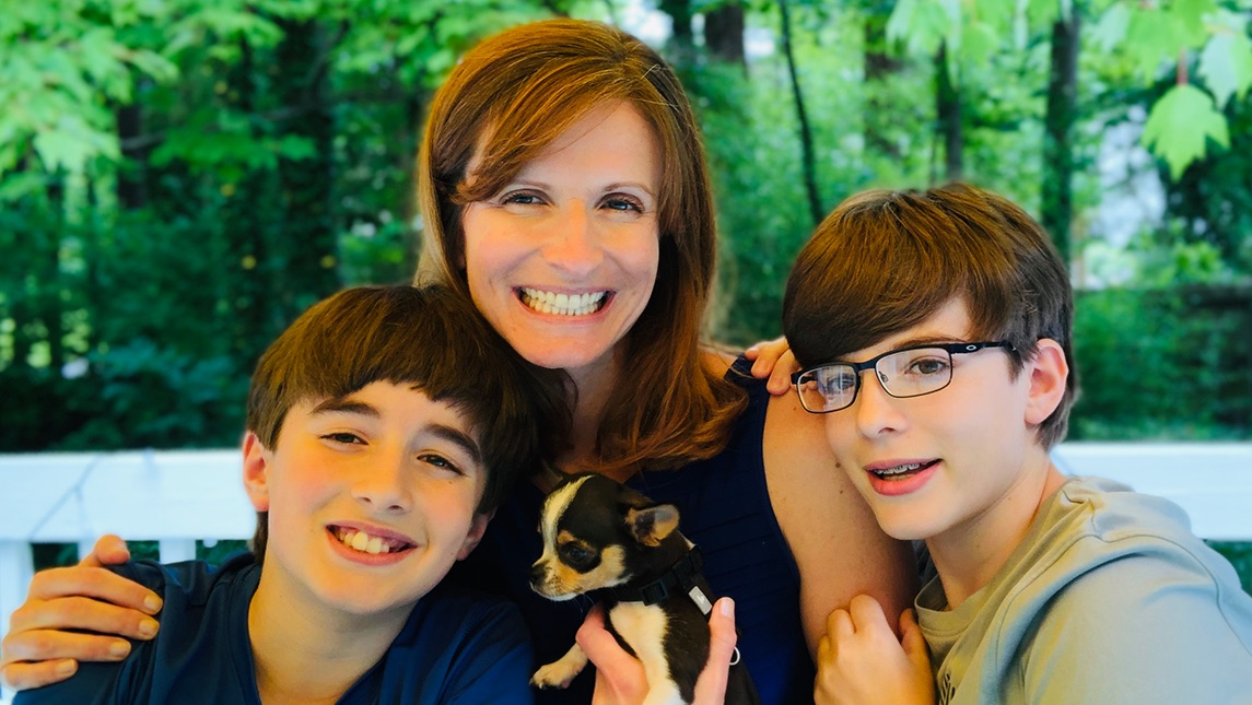 Dr. Christine Murray with her two boys and puppy.