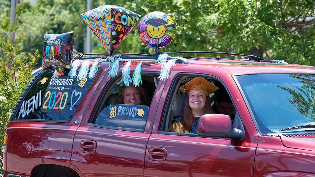 Family in decorated car