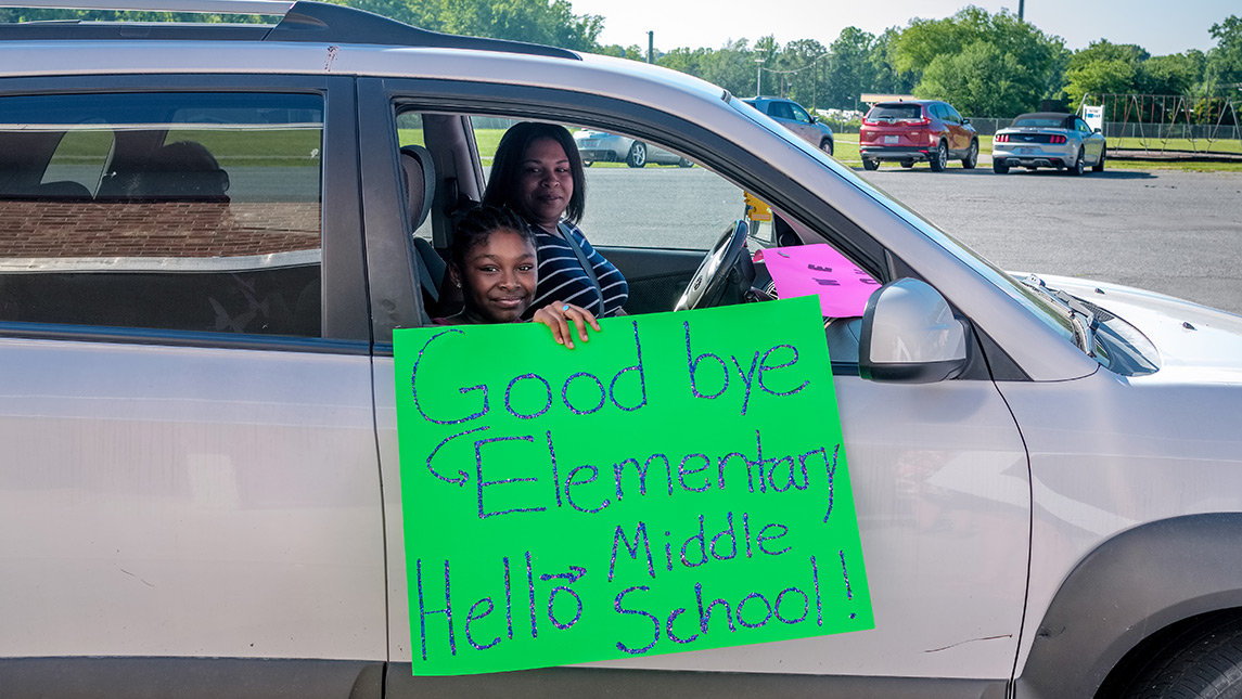 Photo of students and family in car