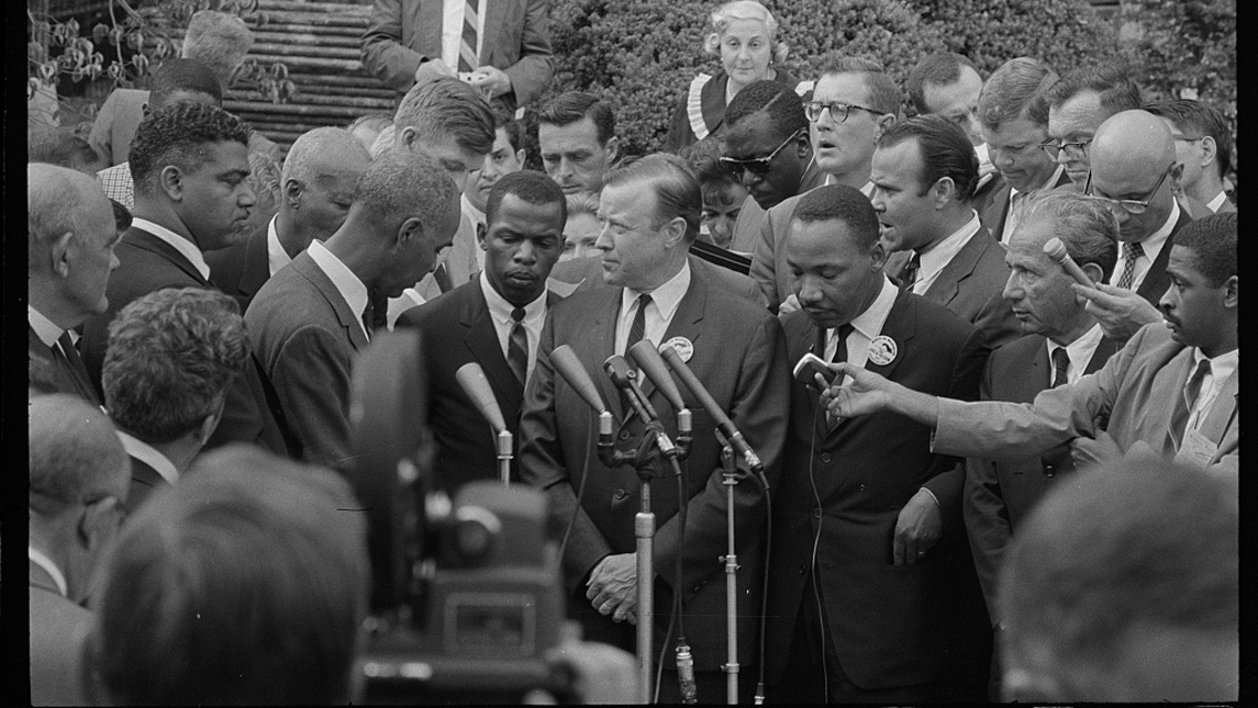 civil rights leaders speak with reporters