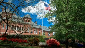 Campus building with American flag