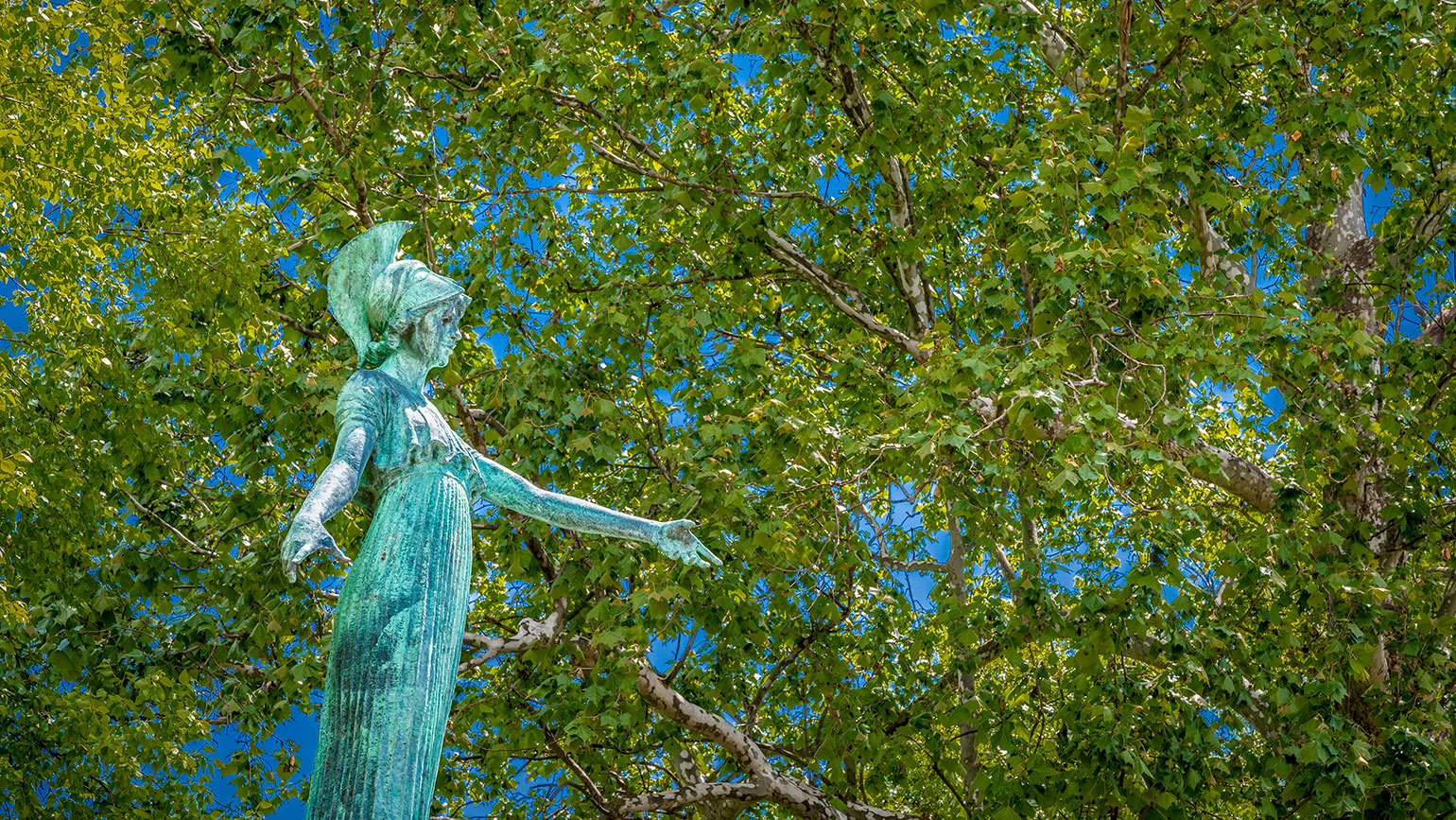 Minerva statue and trees on campus