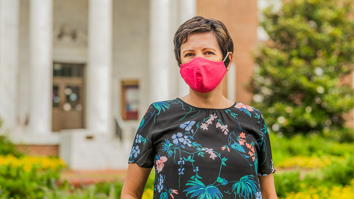 Portrait of Dr. Cassandra Workman wearing mask on campus