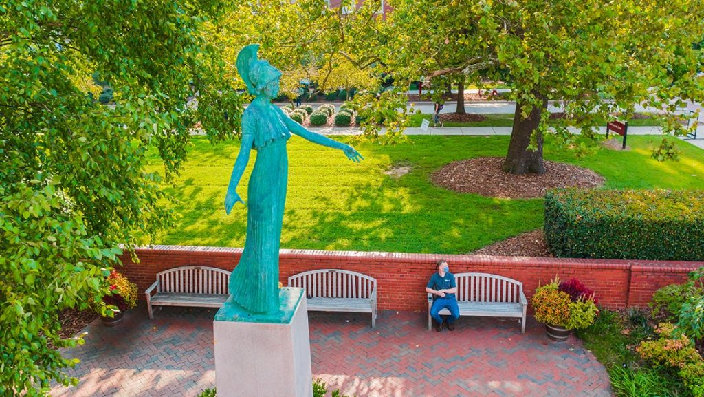 Photo of Minerva statue on the campus of UNCG