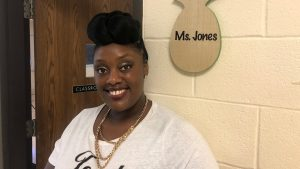 Ebonie Jones standing in front of her classroom