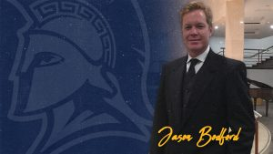 Portrait of Jason Bodford with UNCG logo