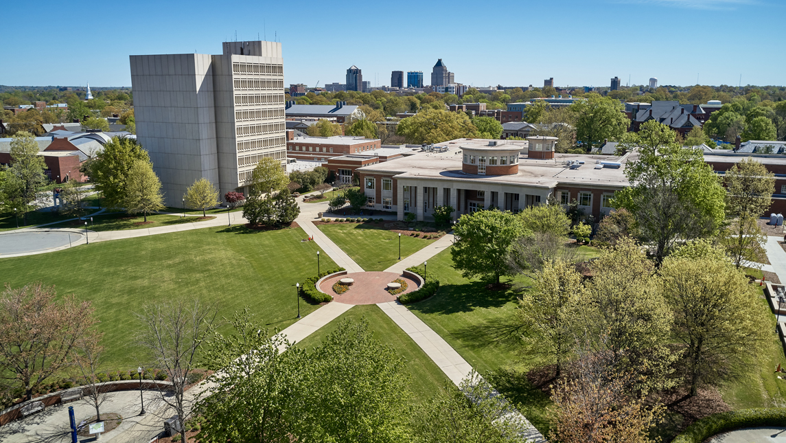 Aerial view of campus with downtown in background