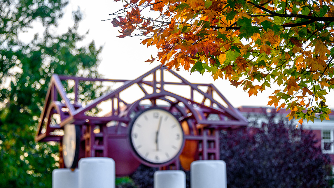 fall foliage with clock tower in background