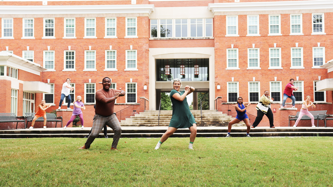 photo of musical theatre students performing on lawn
