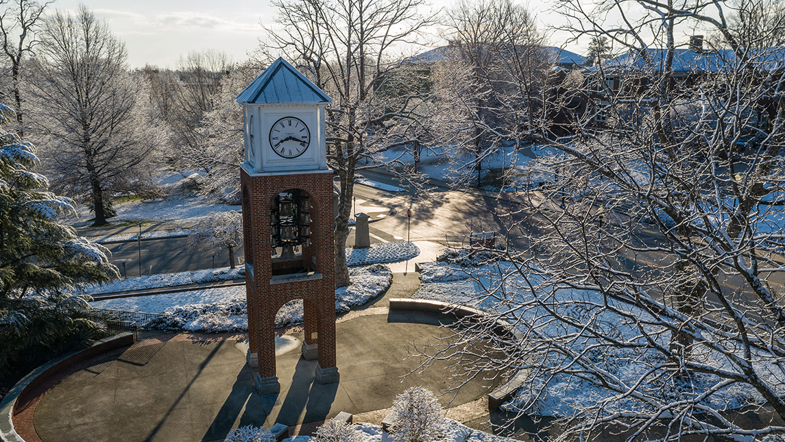 Clock tower and snowy campus