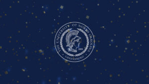 Graphic with UNCG University seal and confetti
