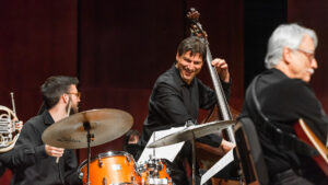man playing bass with ensemble