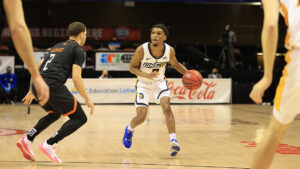 Photo of basketball player dribbling ball during game