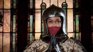 Woman in helmet in church from the UNCG Saint Joan production