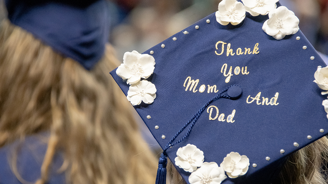 "Photo of graduation cap that says ""Thank you Mom and Dad."""