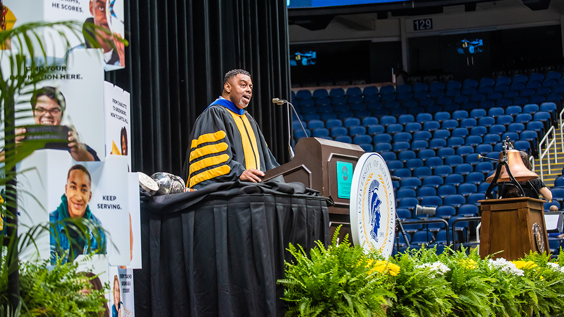 Chancellor Gilliam speaking on stage at Commencement