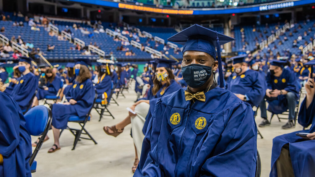 Student at commencement with mask on
