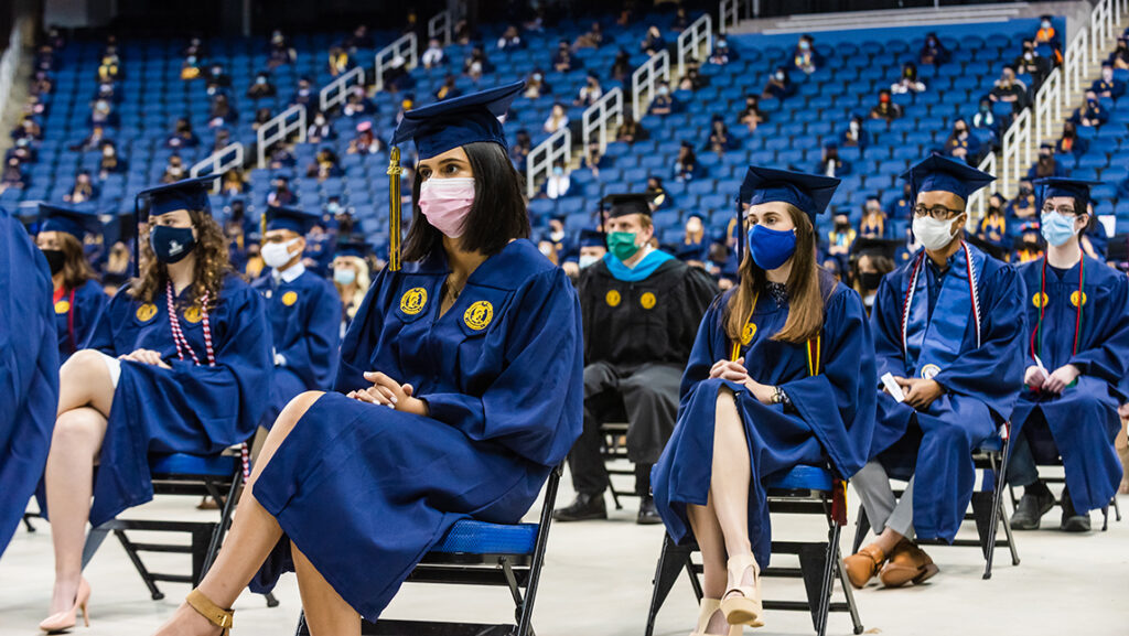 Students sitting six feet apart at commencement