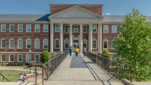 Students walking in front of Petty Building