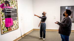 Two individuals looking at artwork in museum gallery